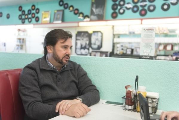 Developer J Dapper is interviewed at Huntridge Pharmacy & Soda Fountain Nov. 6. Jason Ogulnik/View file photo