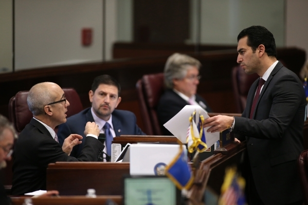 Nevada Senate Democrats, from left, Mo Denis, Mark Manendo and Ruben Kihuen talk on the Senate floor at the Legislative Building in Carson City, Nev., on Friday, Dec. 18, 2015. Lawmakers are worki ...
