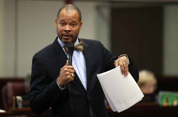 Nevada Senate Minority Leader Aaron Ford, D-Las Vegas, speaks on the Senate floor at the Legislative Building in Carson City, Nev., on Friday, Dec. 18, 2015. Lawmakers are working in a special leg ...