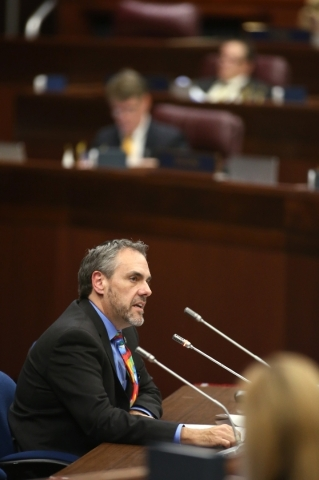 Dale Erquiaga, Gov. Brian Sandoval's chief strategy officer, testifies before the Assembly Committee of the Whole at the Legislative Building in Carson City, Nev., on Friday, Dec. 18, 2015.  ...