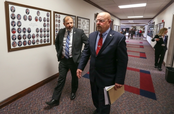 Nevada Assembly Republicans Paul Anderson, left, and Ira Hansen walk through the Legislative Building in Carson City, Nev., on Friday, Dec. 18, 2015. Lawmakers are working in a special legislative ...