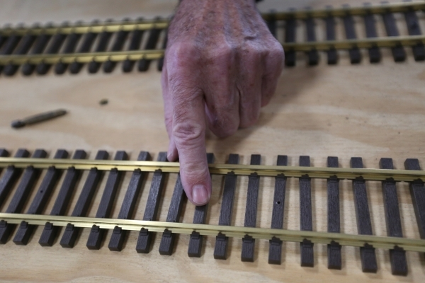 James Hogan points out track that needs to be worked on for the model garden railway display the Las Vegas Railway Society organized at Jim Marsh Kia in northwest Las Vegas Sunday, Dec. 20, 2015.  ...