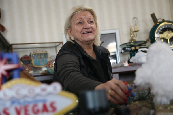 Jean Hayes places figurines on the model garden railway display the Las Vegas Railway Society organized at Jim Marsh Kia in northwest Las Vegas Sunday, Dec. 20, 2015. The display will be open to t ...