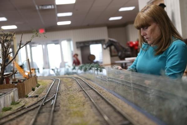 Robin Buchan works on the model garden railway display the Las Vegas Railway Society organized at Jim Marsh Kia in northwest Las Vegas Sunday, Dec. 20, 2015. The display will be open to the public ...