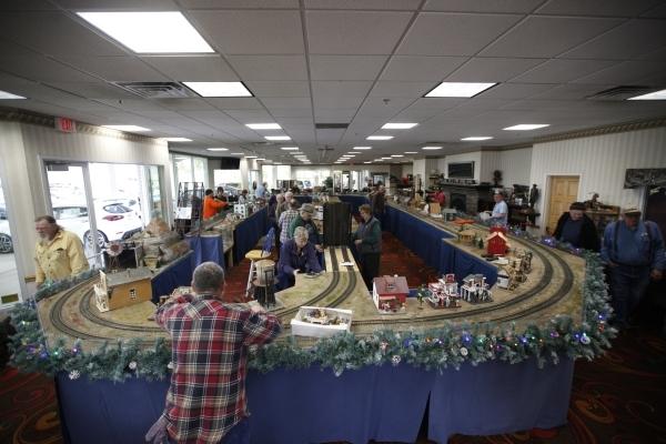 Members of the Las Vegas Garden Railway Society set up  the model garden railway display the Las Vegas Railway Society organized at Jim Marsh Kia in northwest Las Vegas Sunday, Dec. 20, 2015. The  ...