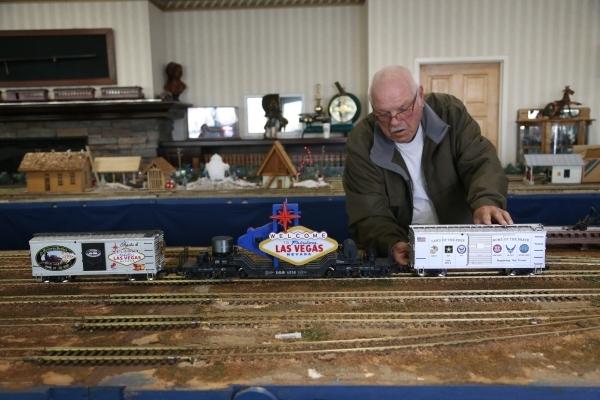 Rik Edwards works on the model garden railway display the Las Vegas Railway Society organized at Jim Marsh Kia in northwest Las Vegas Sunday, Dec. 20, 2015. The display will be open to the public  ...
