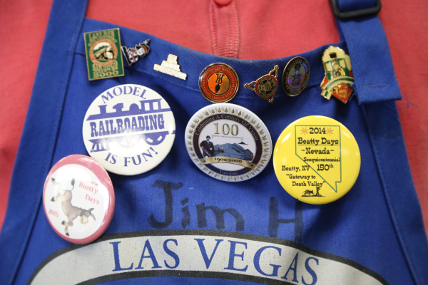 Jim Hayes shows his buttons for model railroad clubs and events at the model garden railway display the Las Vegas Railway Society organized at Jim Marsh Kia in northwest Las Vegas Sunday, Dec. 20, ...