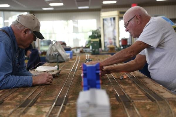 Ron Slavicek and Rik Edwards work on the model garden railway display the Las Vegas Railway Society organized at Jim Marsh Kia in northwest Las Vegas Sunday, Dec. 20, 2015. The display will be ope ...