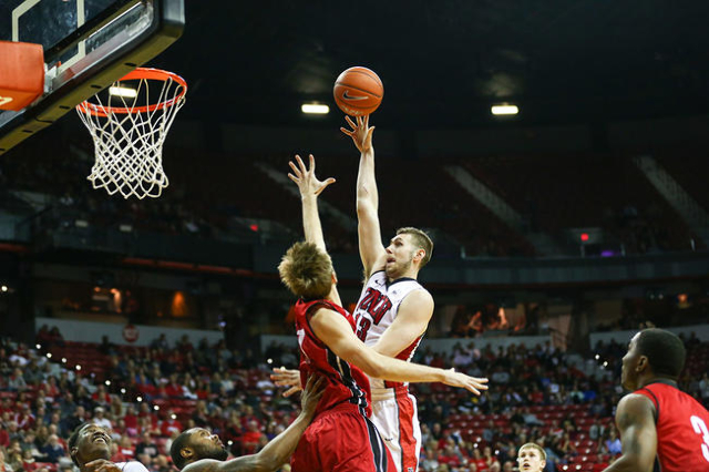 UNLV forward Ben Carter (13) shoots over South Dakota's Eric Robertson (41) during a basketball game at the Thomas & Mack Center in Las Vegas on Tuesday, Dec. 22, 2015. Chase Stevens/Las ...