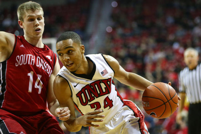 UNLV guard Jalen Poyser (24) drives against South Dakota's Casey Kasperbauer (14) during a basketball game at the Thomas & Mack Center in Las Vegas on Tuesday, Dec. 22, 2015. Chase Steve ...