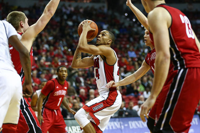 UNLV guard Jalen Poyser (24) shoots against South Dakota during a basketball game at the Thomas & Mack Center in Las Vegas on Tuesday, Dec. 22, 2015. Chase Stevens/Las Vegas Review-Journal Fol ...