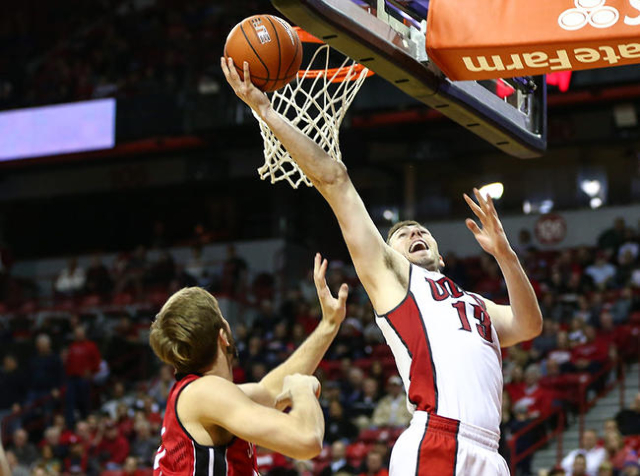 UNLV forward Ben Carter (13) goes in for a shot against South Dakota during a basketball game at the Thomas & Mack Center in Las Vegas on Tuesday, Dec. 22, 2015. UNLV won 103-68. Chase Stevens ...