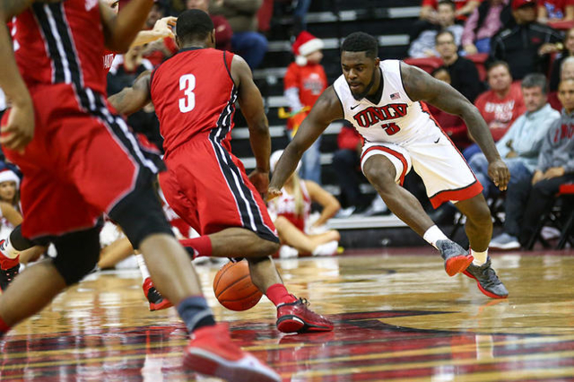 UNLV guard Jordan Cornish (3) moves the ball up court against South Dakota's Shy McClelland during a basketball game at the Thomas & Mack Center in Las Vegas on Tuesday, Dec. 22, 2015. U ...