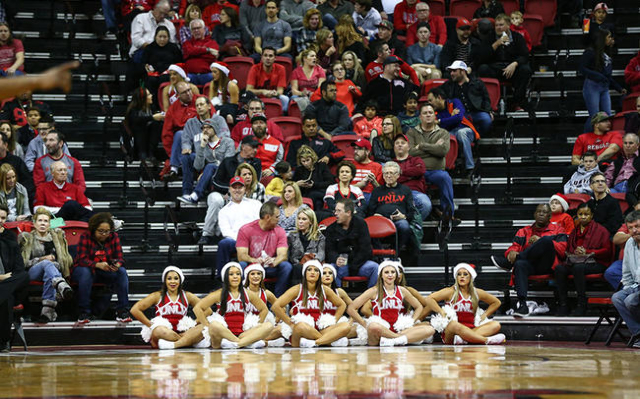 UNLV cheerleaders and fans watch as UNLV plays South Dakota during a basketball game at the Thomas & Mack Center in Las Vegas on Tuesday, Dec. 22, 2015. UNLV won 103-68. Chase Stevens/Las Vega ...