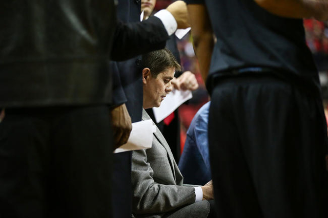 UNLV head coach Dave Rice talks with his team during a time out while playing South Dakota during a basketball game at the Thomas & Mack Center in Las Vegas on Tuesday, Dec. 22, 2015. UNLV won ...