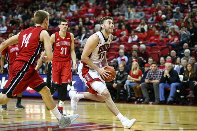 UNLV forward Ben Carter (13) drives to the basket against South Dakota's Casey Kasperbauer (14) and Dan Jech (31) during a basketball game at the Thomas & Mack Center in Las Vegas on Tue ...