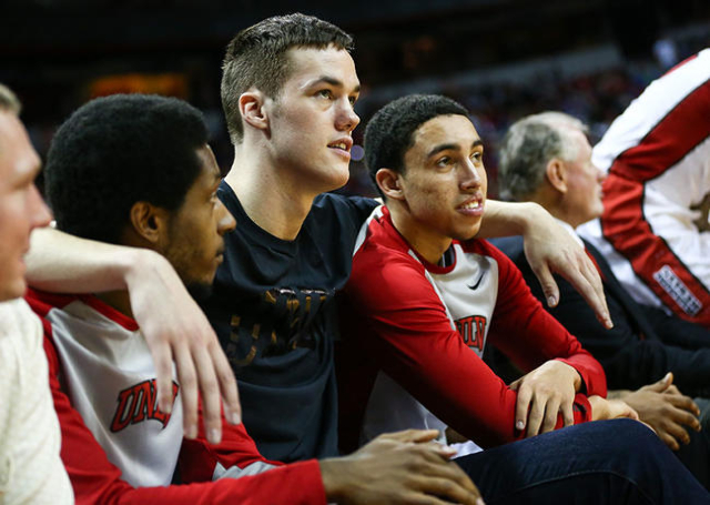 UNLV players, from left, Barry Cheaney, Stephen Zimmerman Jr., and Austin Starr watch their team play South Dakota during a basketball game at the Thomas & Mack Center in Las Vegas on Tuesday, ...
