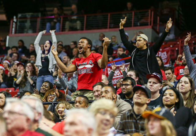 UNLV fans celebrate a three-point shot by UNLV forward Tyrell Green (12) during a basketball game against South Dakota at the Thomas & Mack Center in Las Vegas on Tuesday, Dec. 22, 2015. UNLV  ...