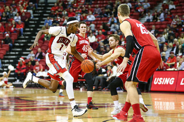 UNLV forward Derrick Jones Jr. (1) drives against South Dakota players, from left, Austin Sparks, Zach Dickerson and Tyler Hagedorn during a basketball game at the Thomas & Mack Center in Las  ...