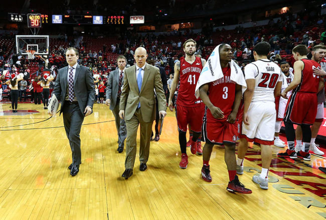 South Dakota players and staff walk off court after losing to UNLV 103-68 during a basketball game at the Thomas & Mack Center in Las Vegas on Tuesday, Dec. 22, 2015. UNLV won 103-68. Chase St ...