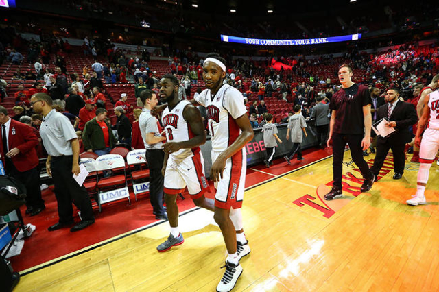 UNLV guard Jordan Cornish (3) and forward Derrick Jones Jr. (1) walk off the court after defeating South Dakota 103-68 in a basketball game at the Thomas & Mack Center in Las Vegas on Tuesday, ...