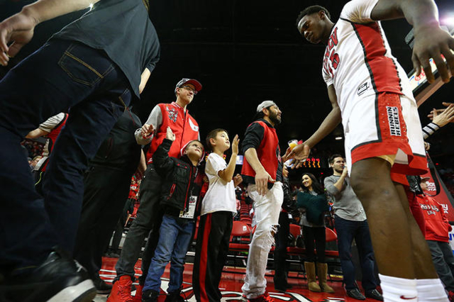 UNLV forward Dwayne Morgan (15) high-fives fans after a basketball game against South Dakota at the Thomas & Mack Center in Las Vegas on Tuesday, Dec. 22, 2015. UNLV won 103-68. Chase Stevens/ ...