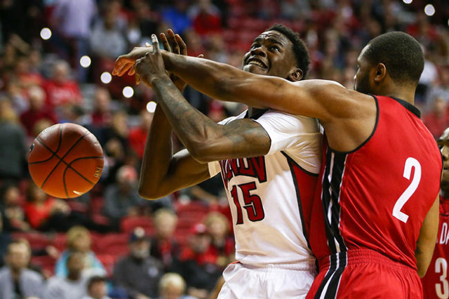UNLV forward Dwayne Morgan (15) is fouled by South Dakota's Tre Burnette (2) during a basketball game at the Thomas & Mack Center in Las Vegas on Tuesday, Dec. 22, 2015. UNLV won 103-68. ...