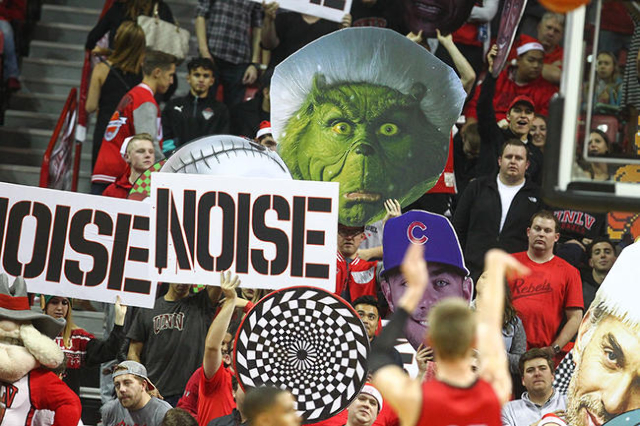 UNLV fans hold up signs as the team plays against South Dakota during a basketball game at the Thomas & Mack Center in Las Vegas on Tuesday, Dec. 22, 2015. UNLV won 103-68. Chase Stevens/Las V ...