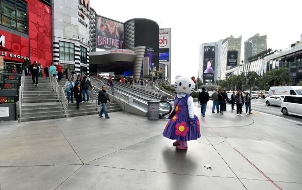 A Hello Kitty character waits to be photographed in front of the Planet Hollywood hotel-casino Monday, Dec. 21, 2015, where police said a car driven by Lakeisha N. Holloway, of Oregon, smashed int ...