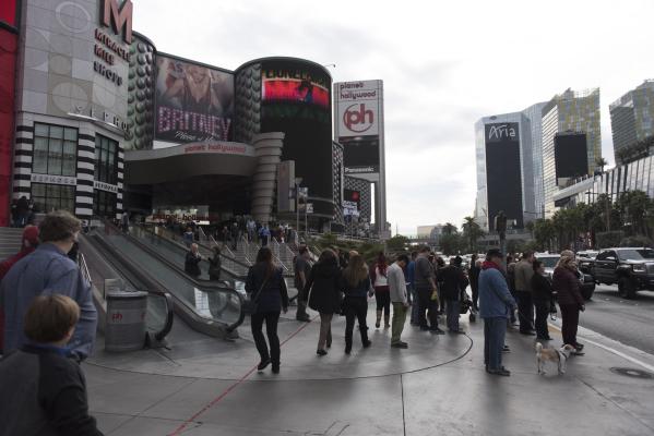 Pedestrians walk on the sidewalk in front of Planet Hollywood Resort & Casino in Las Vegas Monday, Dec. 21, 2015. Jason Ogulnik/Las Vegas Review-Journal.