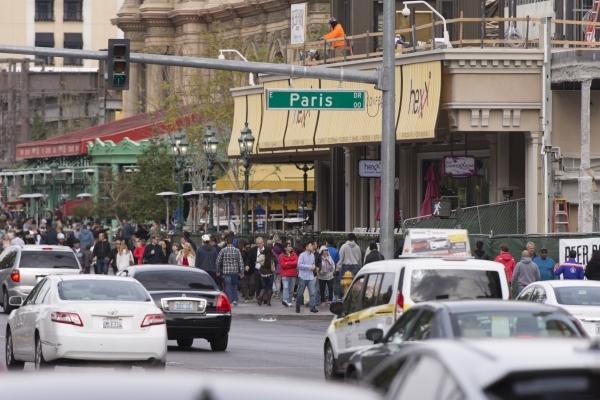 Pedestrians walk on the sidewalk in front of Paris Las Vegas in Las Vegas Monday, Dec. 21, 2015. Jason Ogulnik/Las Vegas Review-Journal.