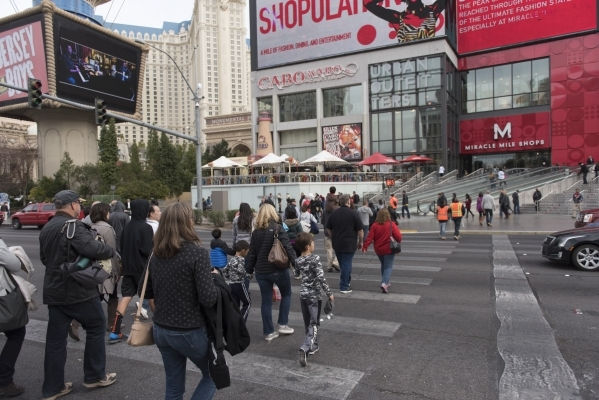 Pedestrians cross Las Vegas Boulevard South in front of Planet Hollywood Resort & Casino in Las Vegas Monday, Dec. 21, 2015. Jason Ogulnik/Las Vegas Review-Journal.
