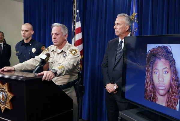 A Sunday night car crash suspect Lakeisha Holloway's photo, right, was displayed as Clark County Sheriff Joe Lombardo speaks about the crash on the Strip during a news conference at Las Vega ...