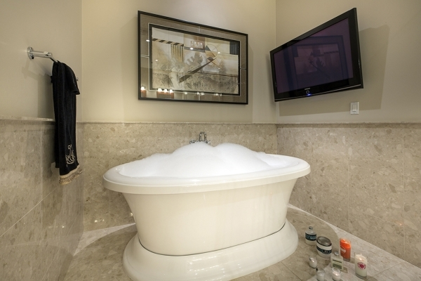 The penthouse on the top flower of Tower I in the Panorama Towers on Dean Martin Drive features two master suites with baths that feature jetted tubs.   COURTESY