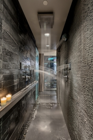 Unit 2400 in Panorama Towers has a master bath that has an omnidirectional, 12-foot, walk-through shower that has been compared to a human car wash.   COURTESY