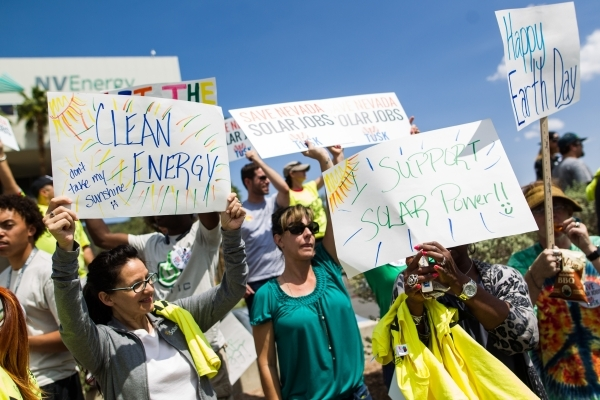 Solar energy supporters protest outside of NV Energy at 6226 W. Sahara Ave. on Wednesday, April 22, 2015. Solar energy proponents want Nevada lawmakers to pass a bill to raise a 3 percent cap on a ...