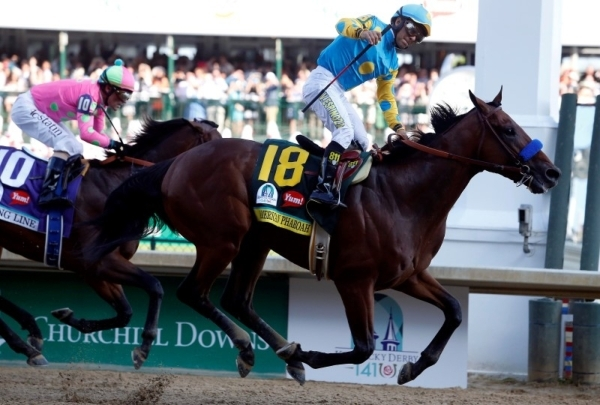 uMay 2, 2015; Louisville, KY, USA; Victor Espinoza aboard American Pharoah celebrates winning the 141st Kentucky Derby at Churchill Downs. Mandatory Credit: Peter Casey-USA TODAY Sports