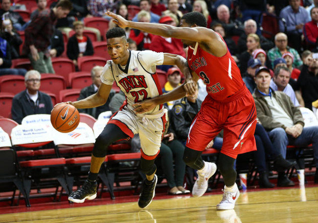 UNLV guard Patrick McCaw (22) is fouled by Fresno State guard Paul Watson (3) during a basketball game at the Thomas & Mack Center in Las Vegas on Wednesday, Dec. 30, 2015. Chase Stevens/Las V ...