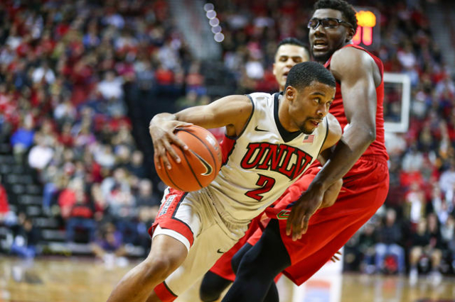UNLV guard Jerome Seagears (2) drives past Fresno State forward Karachi Edo (4) during a basketball game at the Thomas & Mack Center in Las Vegas on Wednesday, Dec. 30, 2015. UNLV lost 69-66 a ...