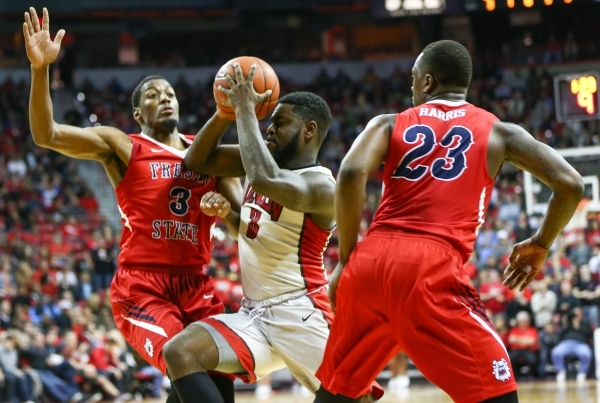 UNLV guard Jordan Cornish (3) drives past Fresno State  guards Paul Watson (3) and Marvelle Harris (23) during a basketball game at the Thomas & Mack Center in Las Vegas on Wednesday, Dec. 30, ...