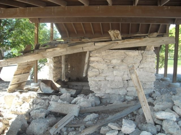 The adobe hut is covered by a shelter after walls collapsed in this 2012 photo, before restoration began. Courtesy photo