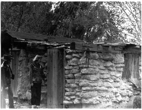 A man and a woman check out the Tule Springs adobe hut in an undated photo. Courtesy photo