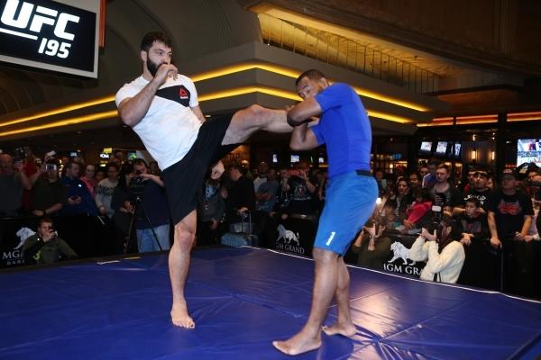 UFC fighter Andrei Arlovski, left, participates during a public workout ahead of his Saturday fight at the MGM Grand casino-hotel in Las Vegas Wednesday, Dec. 30, 2015. Erik Verduzco/Las Vegas Rev ...
