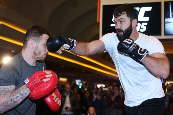 UFC fighter Andrei Arlovski, right, participates during a public workout ahead of his Saturday fight at the MGM Grand casino-hotel in Las Vegas Wednesday, Dec. 30, 2015. Erik Verduzco/Las Vegas Re ...