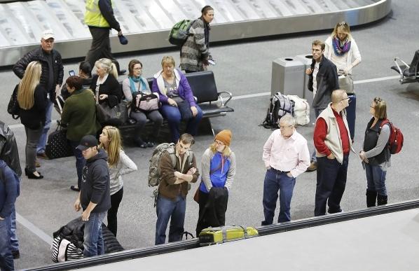 Travelers wait for their luggage at the baggage claim at Terminal-1 at McCarran International Airport on Wednesday, Dec. 30, 2015. Bizuayehu Tesfaye/Las Vegas Review-Journal Follow @bizutesfaye