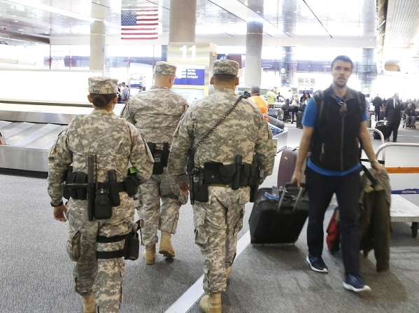 Nevada Army Guard Soldiers, Pfc. Veronica Diaz, left, Capt. Sebastian Balint, center, and Sgt. Johnny Ramirez, right, patrol Terminal-1 at McCarran International Airport on Wednesday, Dec. 30, 201 ...