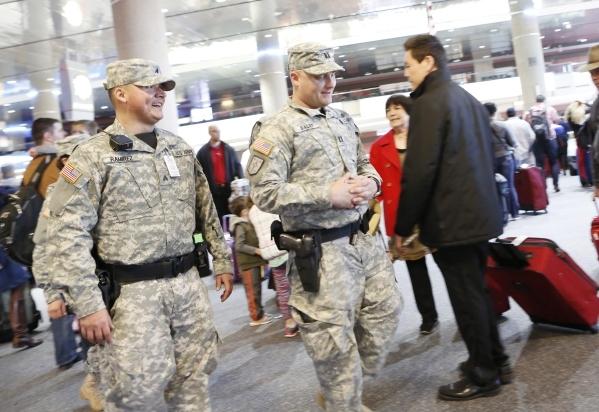 Nevada Army Guard Soldiers Capt. Sebastian Balint, right, and Sgt. Johnny Ramirez, left, patrol Terminal-1 at McCarran International Airport on Wednesday, Dec. 30, 2015. Bizuayehu Tesfaye/Las Vega ...