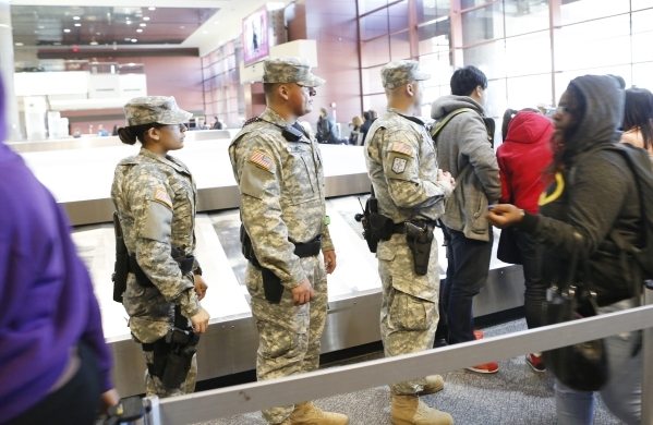 Nevada Army Guard Soldiers, Pfc. Veronica Diaz, left, and Sgt. Johnny Ramirez, center, and Capt. Sebastian Balint, right, patrol Terminal-1 at McCarran International Airport on Wednesday, Dec. 30, ...