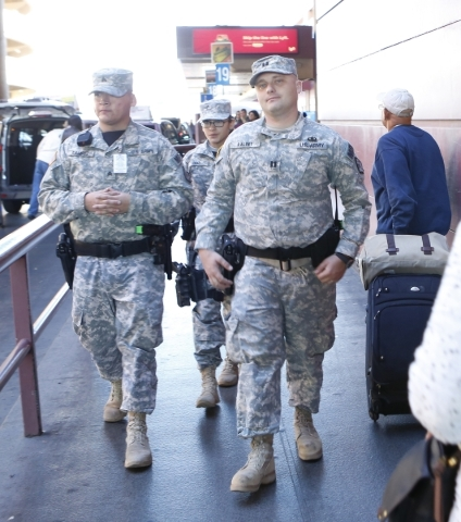 Nevada Army Guard Soldiers, Sgt. Johnny Ramirez, left, Pfc. Veronica Diaz, center, and Capt. Sebastian Balint, right, patrol Terminal-1 at McCarran International Airport on Wednesday, Dec. 30, 201 ...