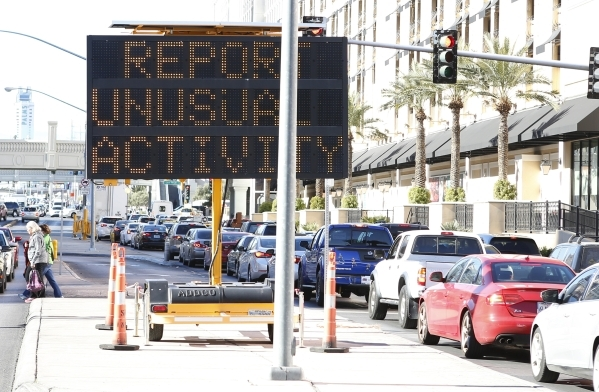 An electronic sign reminding people who come to celebrate the New Year on the Strip to report unusual activity is seen on Wednesday, Dec. 30, 2015, on Flamingo Road, near Las Vegas Boulevard. Bizu ...